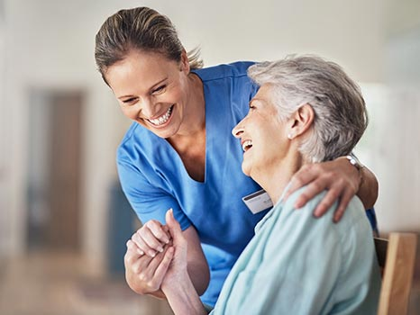 a nurse laughing with a patient